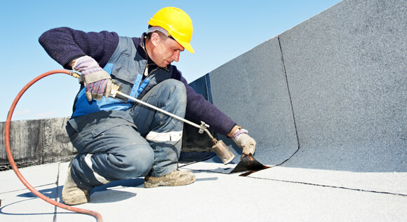 Help finding the best flat roof material and how to get it insured